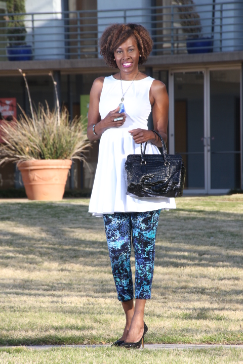 wearing a top as a dress white dress with capri pants and bag
